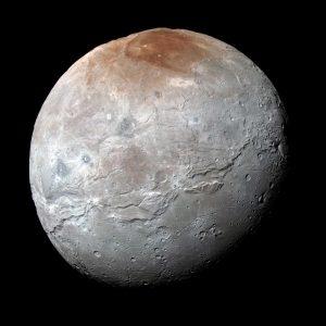 Gray rocky moon with reddish north polar cap.