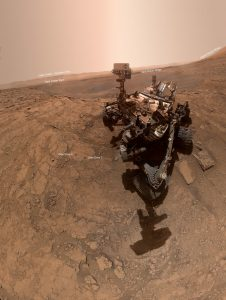 Rover on Mars surface with annotations.