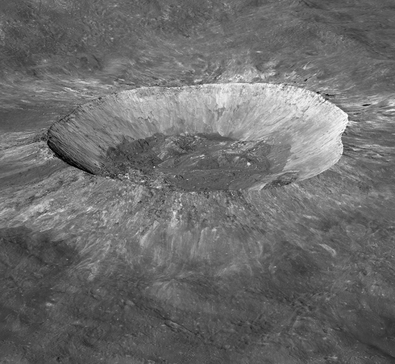 Oblique view of large crater on the moon with lighter gray sloping sides and dark center.