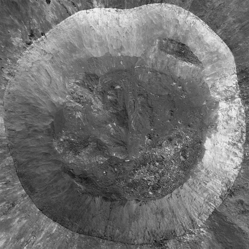 Large crater seen from directly overhead. Wide gray circle with rough darker gray center.