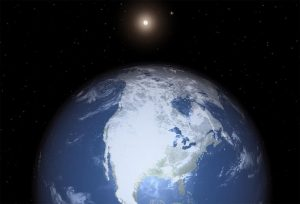 Planet with oceans, continents and ice with star in background.