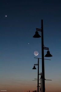 Moon and planets Venus and Jupiter at dusk.