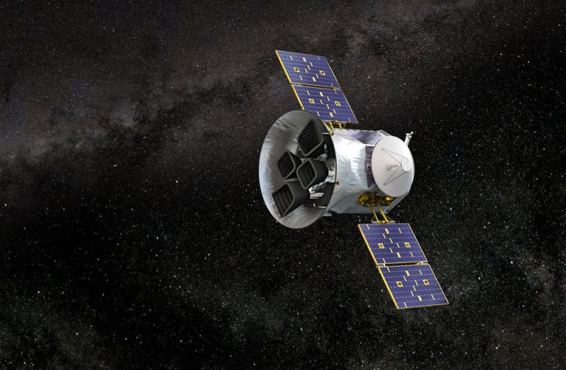 Illustration of a cylindrical spacecraft with square solar panel wings in black space.