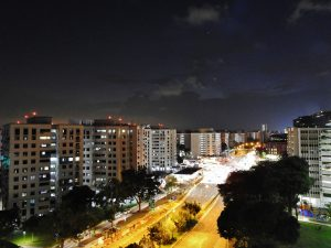 Venus and Jupiter over a brightly lit city street.