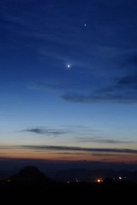 Two very bright planets in a twilight sky.