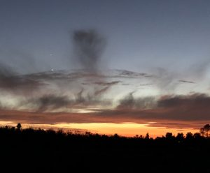 Two shining planets in a twilight sky that also contains virga, or rain that doesn't reach the ground.