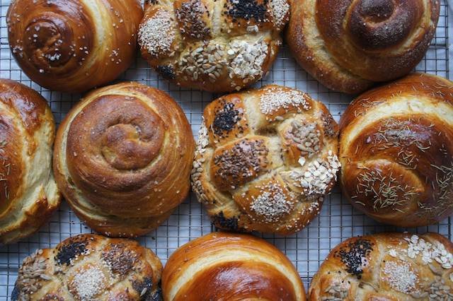 Round loaves of bread on table viewed from above.