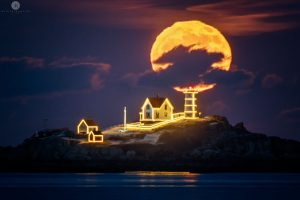 Big full moon and a lighthouse covered with holiday lights.