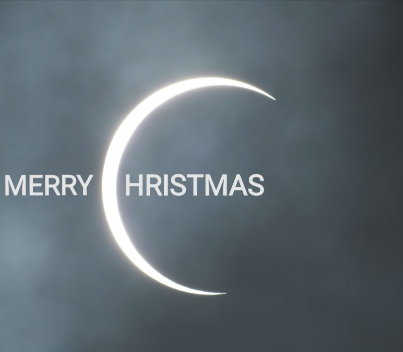 The crescent C of the eclipse has been used to spell out Merry Christmas.