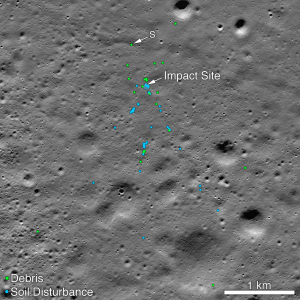 A portion of the moon with blue and green dots indicating spacecraft debris and soil disturbance.
