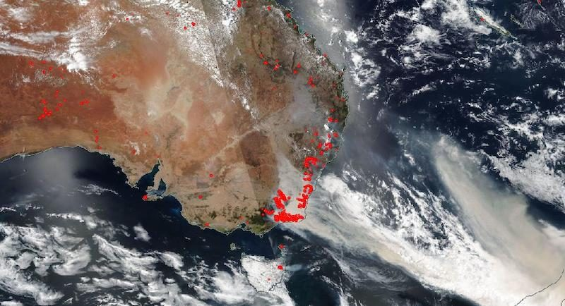 A satellite image of Australia's eastern coastline, with swathes of very many red dots.