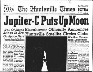 """The front page of the Huntsville Times that says """"Jupiter-C Puts Up Moon."""""""