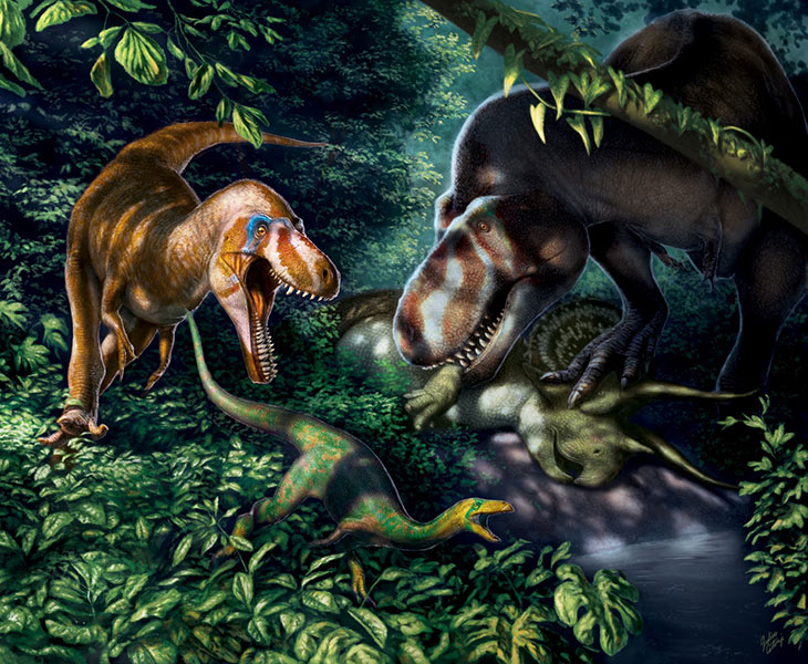 Young dinosaurs in forest, one chasing a smaller dinosaur, another with prey in its mouth.