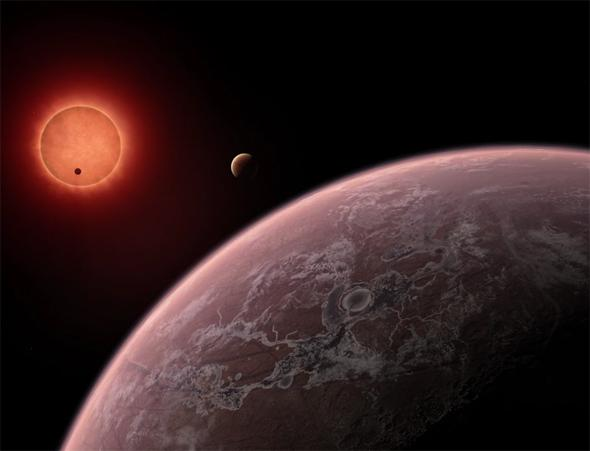 Three planets near a small red star.