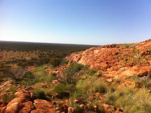 Treeless rocky area with scrub. Blue sky.