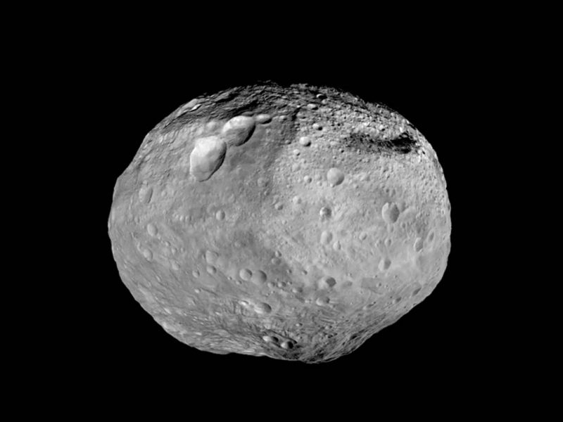 A slightly oblong, roundish rocky body with a lot of craters on it.