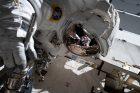 Reflection of an astronaut in an astronaut's helmet.