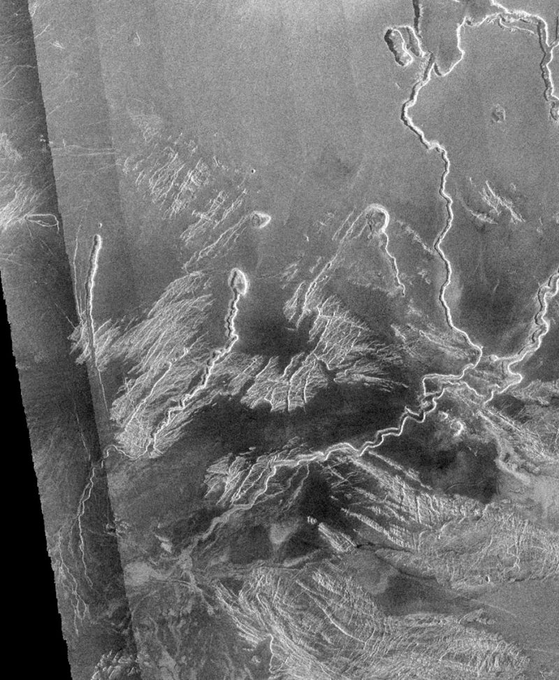 Gray surface with long, narrow, sinuous channels and rough patches.