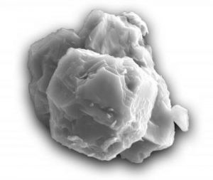 Clump of gray-colored grains on white background.