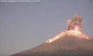 Video still of volcanic eruption: fire, smoke, lava.