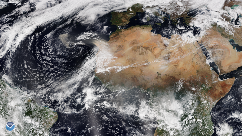 Northern Africa with a long streamer of cloud over the Sahara Desert.