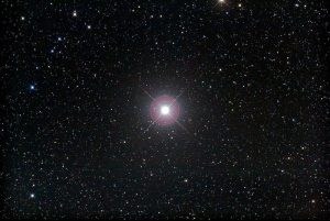 Image of bright star Pollux against a backdrop of fainter stars.