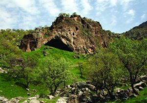 A view of Shanidar Cave from a distance, showing the entrance.
