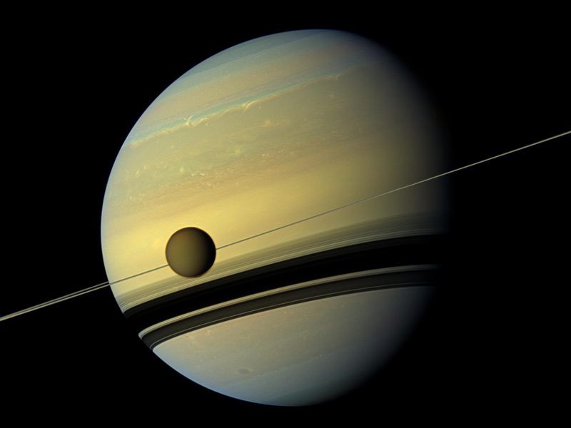 Planet with ring and large moon.