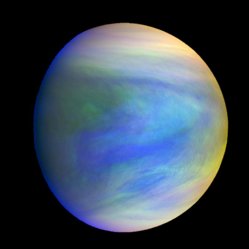 Planet with multi-colored cloud streaks against black space.