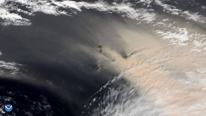 Dust over the ocean, with islands barely visible in the dust.