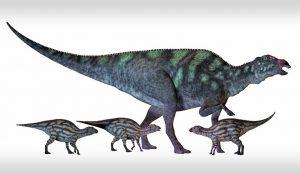 a birg dinosaur and 3 smaller dinosaurs.