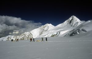 Snow-covered mountaintop with people.
