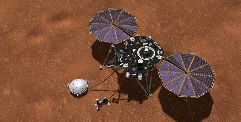 Spacecraft on a brown surface.
