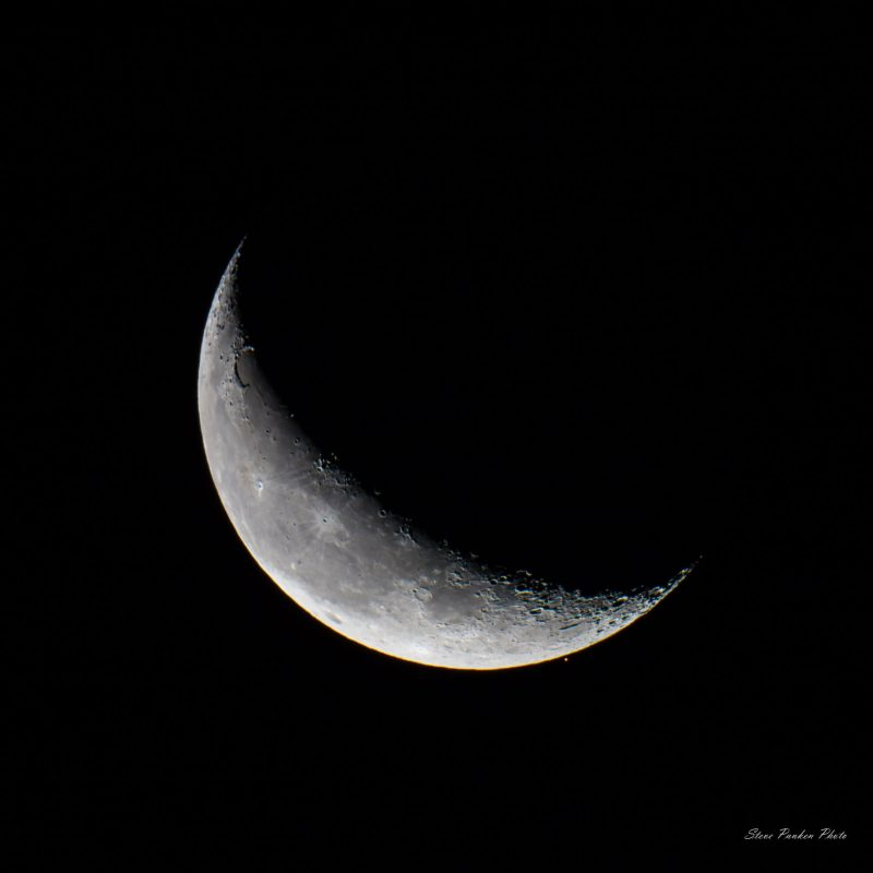 white crescent on a black background.