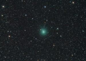 Fuzzy green object in dense starfield