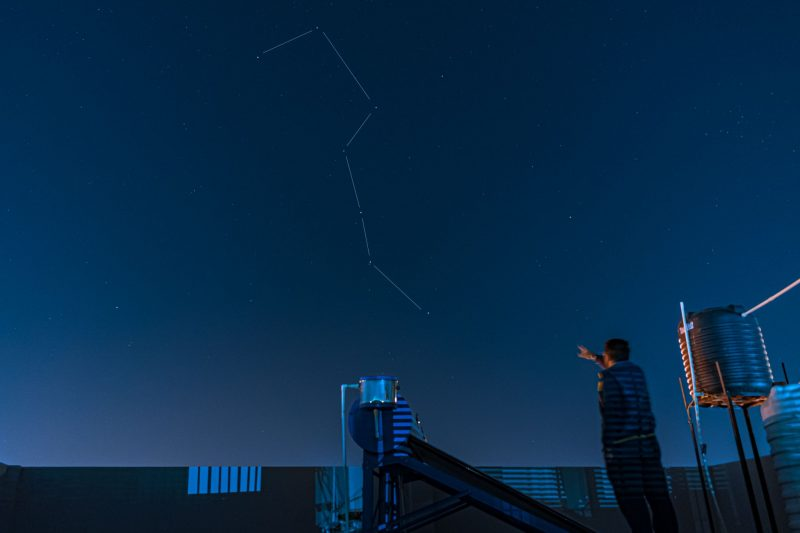 A man points to the Big Dipper.