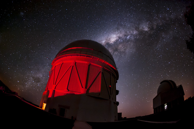 Telescope dome with starry night sky in background.
