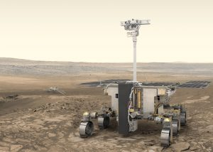 Robot with wheels on rocky ground.