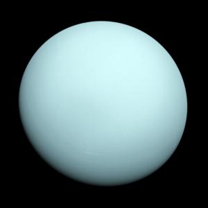 Featureless bluish ball on black background.