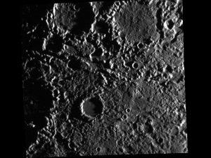 Dark gray bumpy and cratered terrain.