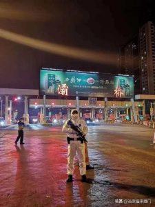 Man in a mask, in Asia, in an empty street.