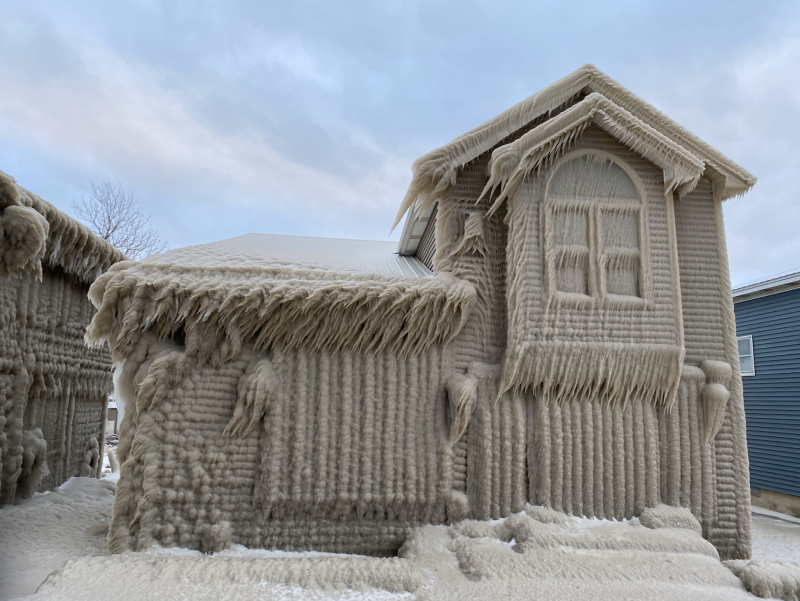 House covered with windblown ice.