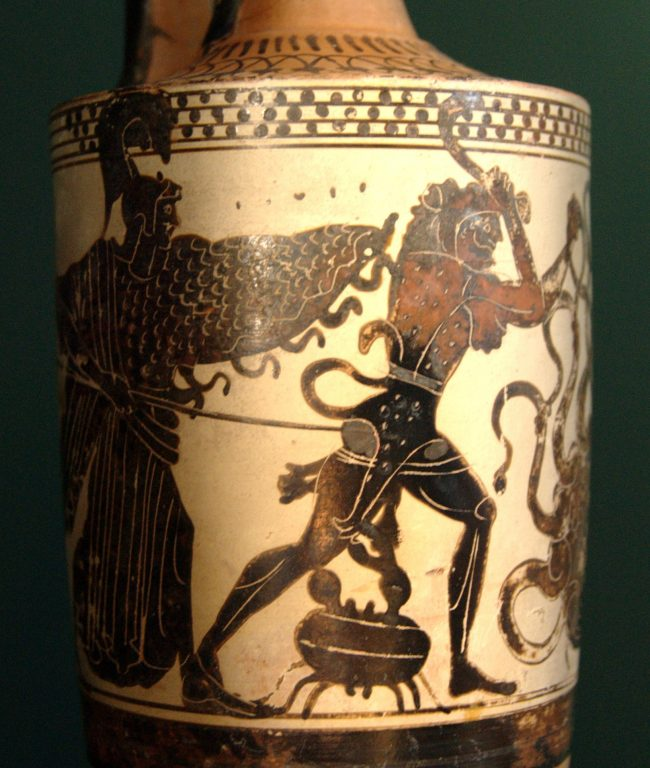 White pot with red and black scene of hero with Athena, large crab, and snaky-necked Hydra.