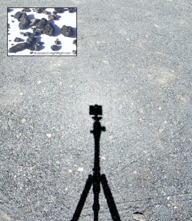 The shadow of a tripod cast on a flat gravel surface, with inset closeup of gravel.