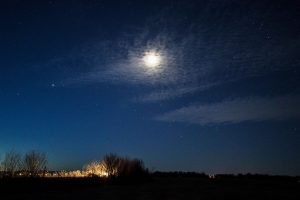 Night scene with moon and bright planets.