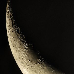 Close-up of a portion of the waning crescent moon.