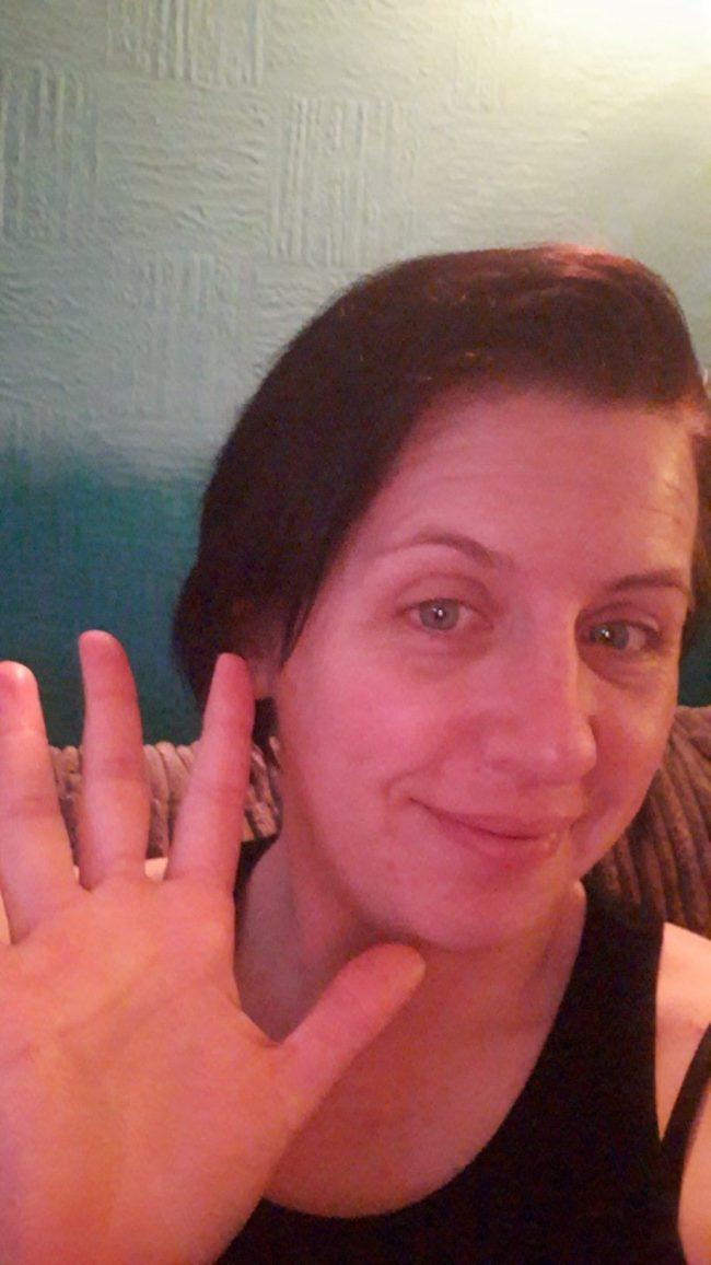 Smiling, waving woman.