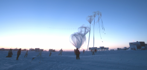 It looks as if multiple weather balloons are being launched, but it's really just one: a translucent balloon above a snowy terrain.