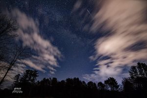 Dark sky with clouds and thin while stripel
