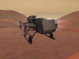 Drone-like machine flying over brownish desert with orangish sky.